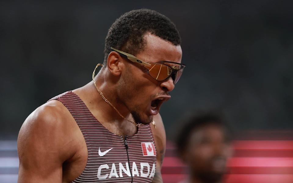 Andre De Grasse of Canada celebrates after winning gold in the men's 200m - REUTERS