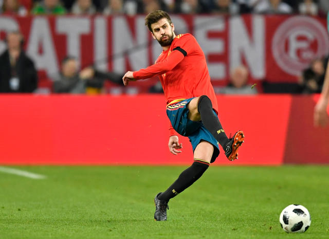 FILE - In this Friday, March 23, 2018 file photo, Spain's Gerard Pique plays during an international friendly soccer match between Germany and Spain in Duesseldorf, Germany. (AP Photo/Martin Meissner, File)