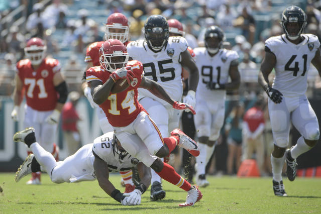 Kansas City Chiefs wide receiver Sammy Watkins (14) dodges a tackle by Jacksonville Jaguars linebacker Najee Goode (52) during the first half of an NFL football game, Sunday, Sept. 8, 2019, in Jacksonville, Fla. (AP Photo/Phelan M. Ebenhack)