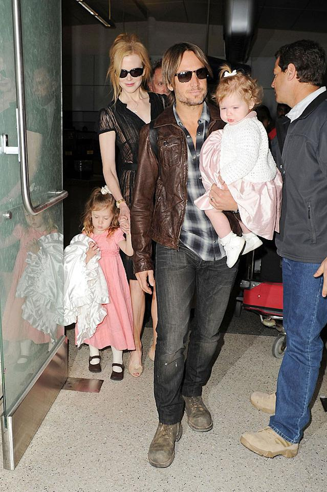 "Nicole Kidman and Keith Urban arrived at LAX with their lookalike  redhead daughters Sunday Rose, 3, and Faith Margaret, 14 months, on  Wednesday. The family has been in Sydney, where Keith is filming the  Australian version of ""The Voice,"" alongside fellow coaches Seal, Delta  Goodrem, and Joel Madden. (2/29/2012)"