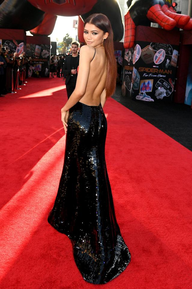 in a glittering two-tone Armani Privé open-back gown embroidered in black and red paillettes, plus black pumps at the premiere of <em>Spider-Man Far from Home</em> in Hollywood.