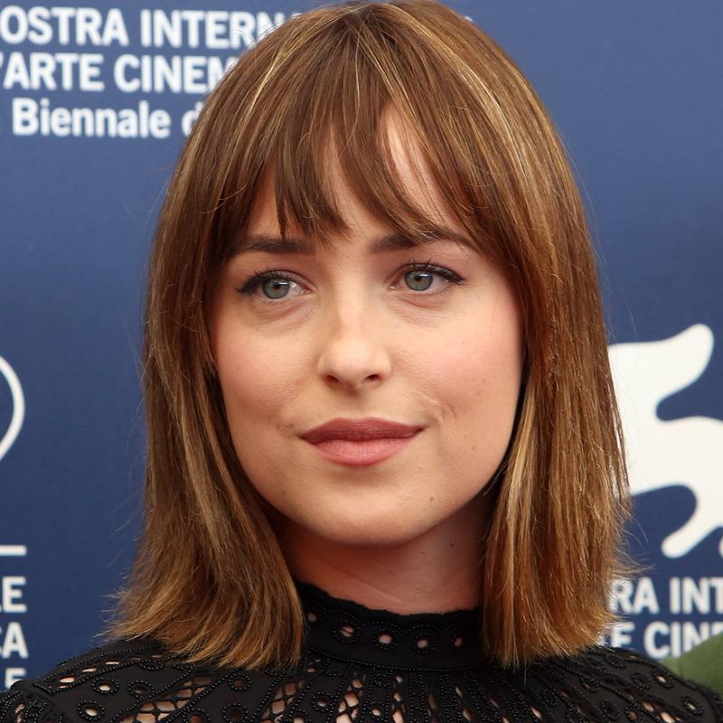 "At a photocall for her film ""Black Mass,"" Johnson keeps her 'do simple, with her bangs falling naturally against her forehead. Perfect bangs for day."