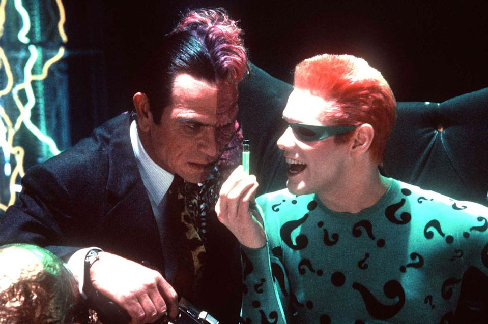 """TWO-FACE (TOMMY LEE JONES) AND THE RIDDLER (JIM CARREY) CONSPIRE TO DESTROY BATMAN IN """"BATMAN FOREVER"""" (Getty Images)"""