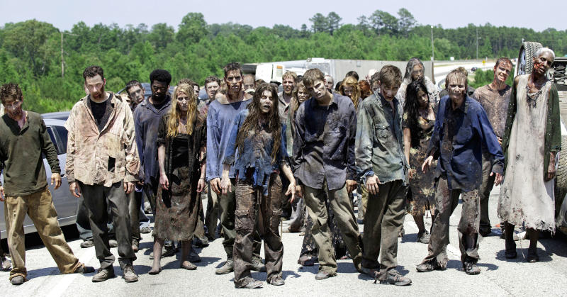 """FILE - In this image released by AMC, zombies appear in a scene from the second season of the AMC original series, """"The Walking Dead,"""" in Senoia, Ga. The series' fourth season premieres on Oct. 13. Crews have been filming the new episodes in Georgia, but they keep locations of future episodes closely-guarded secrets until the shows air. In Grantville, Ga., the town's ruins were featured prominently last season. In nearby Senoia, many scenes are filmed in the historic downtown area, transforming into the fictional town of Woodbury for the show. (AP Photo/AMC, Gene Page) NO SALES"""