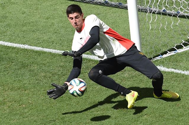 Belgium's goalkeeper Thibaut Courtois dives for the ball before a quarter-final match against Argentina at the Mane Garrincha National Stadium in Brasilia on July 5, 2014 during the 2014 FIFA World Cup (AFP Photo/Evaristo Sa)