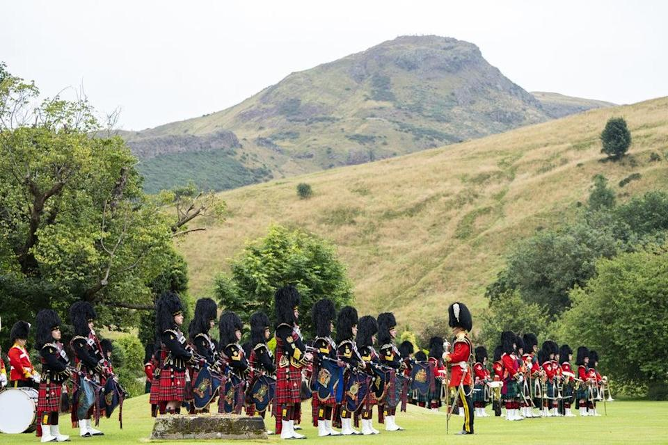 The massed pipes and drums during a service in the palace gardens (Jane Barlow/PA) (PA Wire)