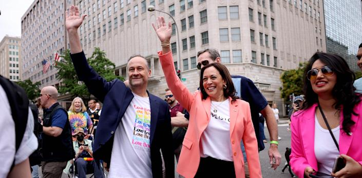 WASHINGTON, DC - JUNE 12: U.S. Vice President Kamala Harris and husband Doug Emhoff wave as they join marchers for the Capital Pride Parade on June 12, 2021 in Washington, DC. Capital Pride returned to Washington DC, after being canceled last year due to the Covid-19 pandemic. (Photo by Anna Moneymaker/Getty Images)