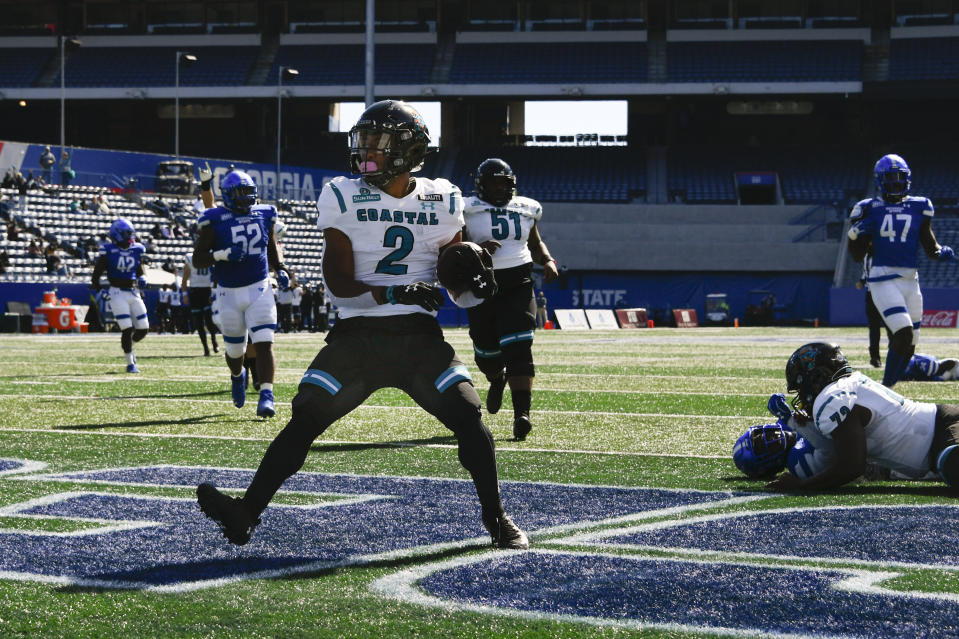 Coastal Carolina running back Reese White (2) scores a touchdown during the first half of an NCAA football game against Georgia State, Saturday, Oct. 31, 2020, in Atlanta. (AP Photo/John Amis)