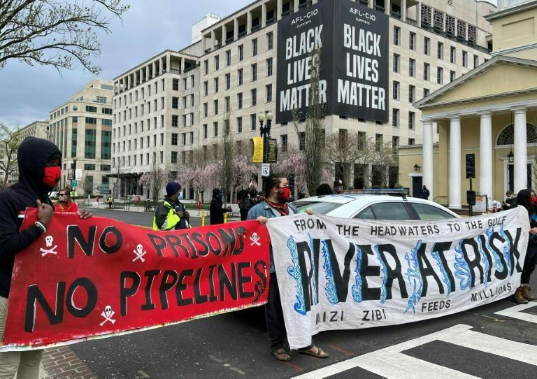 Activists in April 2021 display banners referring to the shutting down of existing oil pipelines in the northern United States at Black Lives Matter Plaza in Washington