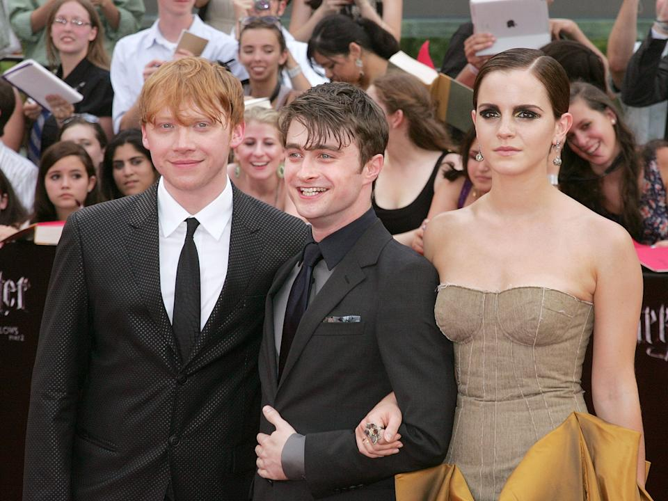 "Rupert Grint, Daniel Radcliffe and Emma Watson attend the premiere of ""Harry Potter and the Deathly Hallows — Part 2"" in 2011."