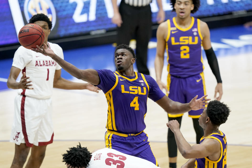 LSU's Darius Days (4) reaches for a rebound during the first half of the championship game against Alabama at the NCAA college basketball Southeastern Conference Tournament Sunday, March 14, 2021, in Nashville, Tenn. (AP Photo/Mark Humphrey)