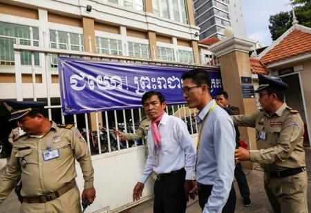 Uon Chhin and Yeang Sothearin, former journalists from the U.S.-funded Radio Free Asia (RFA), who have been charged with espionage, arrive at the Municipal Court of Phnom Penh for their verdict, in Phnom Penh