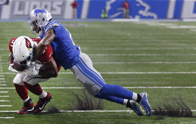 <p>Detroit Lions free safety Glover Quin (27) tackles Arizona Cardinals running back David Johnson (31) during the first half of an NFL football game in Detroit, Sunday, Sept. 10, 2017. (AP Photo/Jose Juarez) </p>