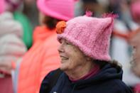 <p>A woman in a light-pink pussy hat with pom poms in Boston. (Photo: Getty Images) </p>