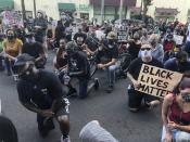 Protesters kneel in front of the Lehigh County Jail in Allentown, Pa., on Monday, July 13, 2020, to demonstrate against police brutality after video emerged of an officer placing his knee on a man's head and neck area outside a city hospital. Police have launched an internal probe. (AP Photo/Michael Rubinkam)