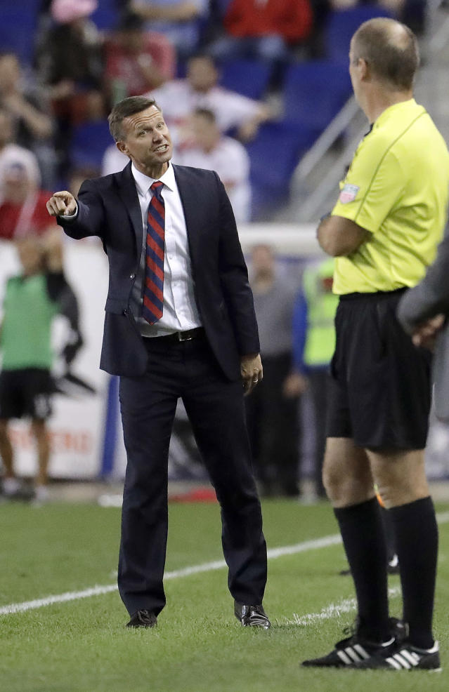 FILE - In this July 29, 2017, file photo, New York Red Bulls coach Jesse Marsch, left, talks to official Silviu Petrescu during the second half of the team's MLS soccer match against the Montreal Impact, in Harrison, N.J. Marsch has resigned as coach of Major League Soccer's New York Red Bulls and has been replaced by top assistant Chris Armas, a former U.S. national team defender.The Red Bulls made the announcement on Friday, July 6, 2018. (AP Photo/Julio Cortez, File)