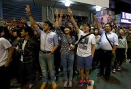 """FILE PHOTO: Pro-democracy protesters imitate a three-finger salute from movie """"The Hunger Games"""", during a rally at Mong Kok shopping district in Hong Kong"""