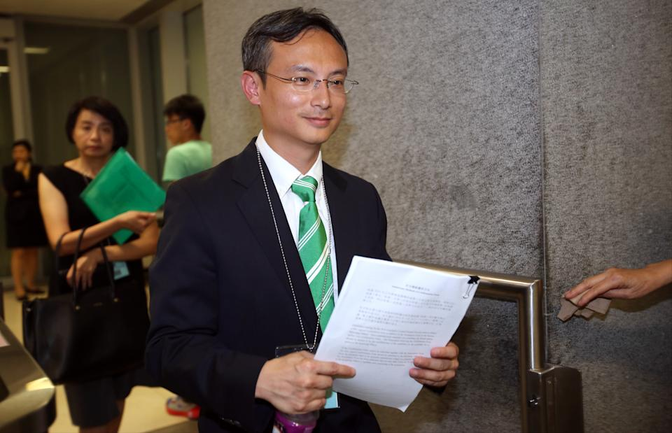 Dr Pierre Chan Pui-yin, former president of the Public Doctors' Association, submits his application to run in the Legco election outside CGO in Tamar. 26JUL16 SCMP/Edward Wong (Photo by Edward Wong/South China Morning Post via Getty Images)