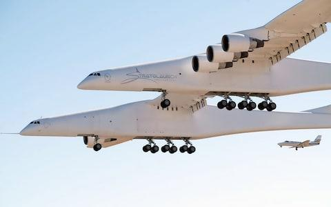 The Stratolaunch aircraft has two fuselages and is powered by six Boeing 747 engines - Credit: AFP