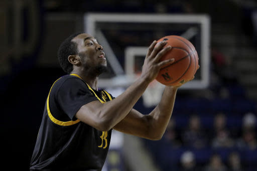 East Carolina guard Miles James prepares to shoot against Navy during the first half of an NCAA college basketball game at the Veterans Classic Tournament, Friday, Nov. 8, 2019, in Annapolis, Md. (AP Photo/Julio Cortez)