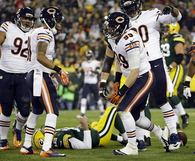 Green Bay Packers' Aaron Rodgers lays on the ground after being sacked by Chicago Bears' Shea McClellin during the first half of an NFL football game Monday, Nov. 4, 2013, in Green Bay, Wis. (AP Photo/Morry Gash)