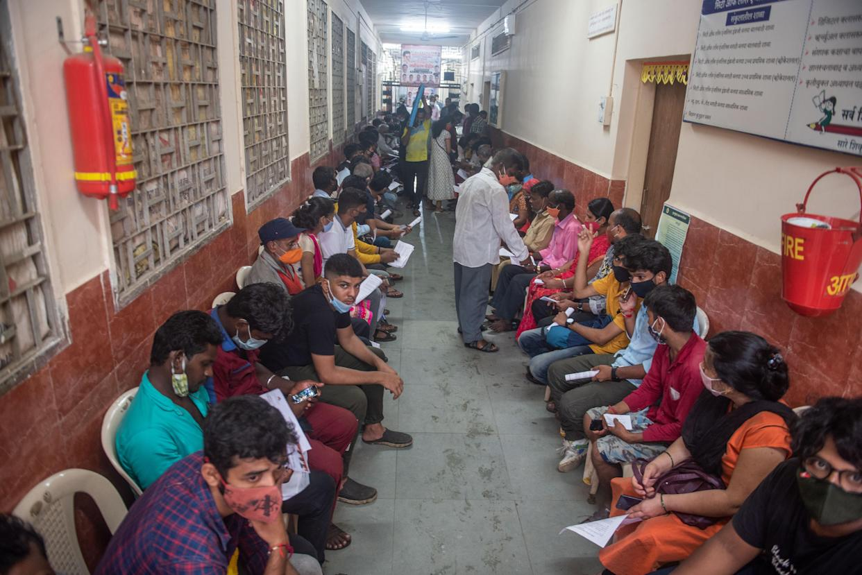 MUMBAI, INDIA - SEPTEMBER 8: Beneficiaries wait in a queue to get inoculated against Covid-19 during a free vaccination camp at Matunga (West), on September 8, 2021 in Mumbai, India. (Photo by Pratik Chorge/Hindustan Times via Getty Images)
