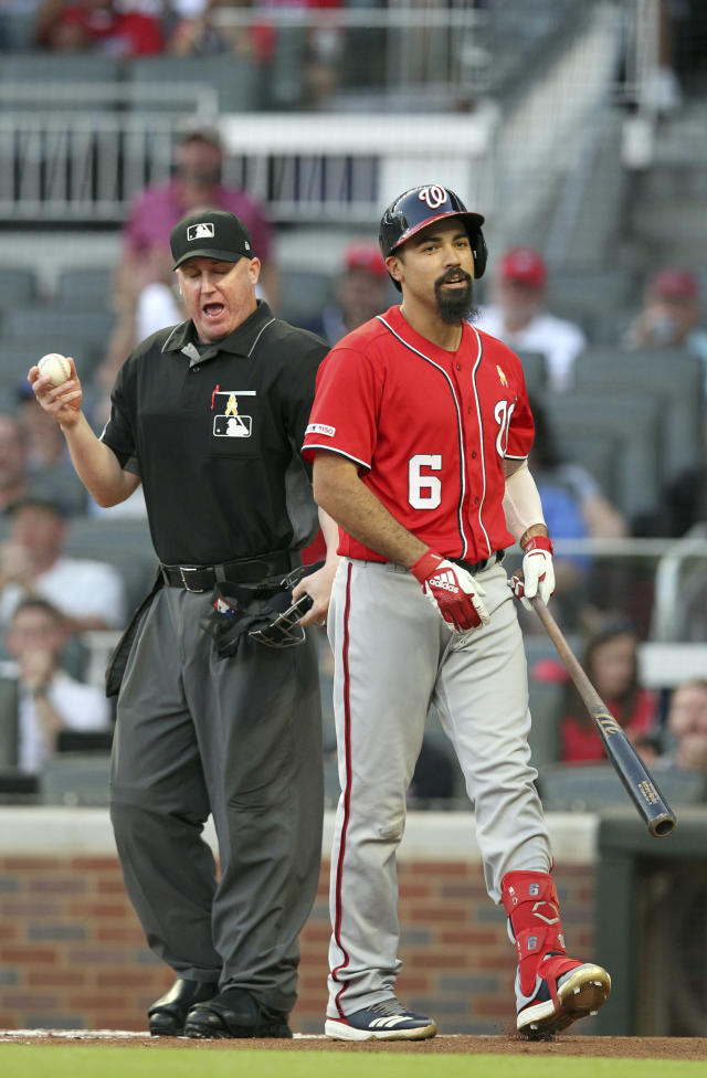 Washington Nationals batter Anthony Rendon (6) talks back to home plate umpire Ryan Blakney after being called out on strikes during the first inning of a baseball game against the Atlanta Braves, Saturday, Sept. 7, 2019, in Atlanta. (AP Photo/Tami Chappell)