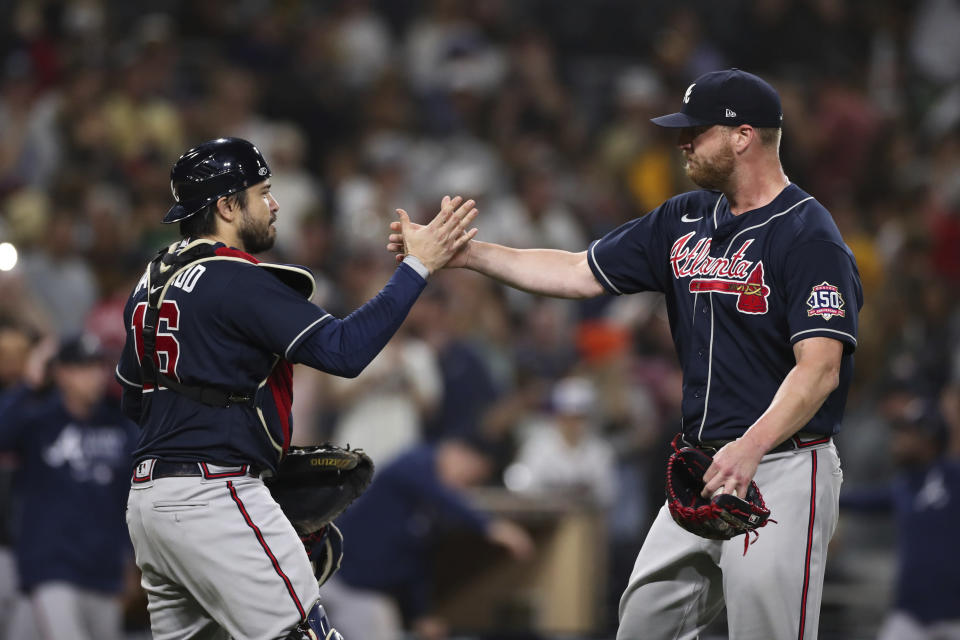 Atlanta Braves relief pitcher Will Smith, right, celebrates with catcher Travis d'Arnaud (16) after they defeated the San Diego Padres in a baseball game Saturday, Sept. 25, 2021, in San Diego. (AP Photo/Derrick Tuskan)
