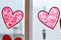"<p>Use colorful tissue paper between clear contact paper to create heart-shaped sun catchers. This DIY is easy enough for kids of all ages.</p><p><em><a href=""https://threelittleferns.com/2019/02/valentines-heart-sun-catcher-craft.html"" rel=""nofollow noopener"" target=""_blank"" data-ylk=""slk:Get the how-to at Three Little Ferns»"" class=""link rapid-noclick-resp"">Get the how-to at Three Little Ferns»</a></em><br></p>"