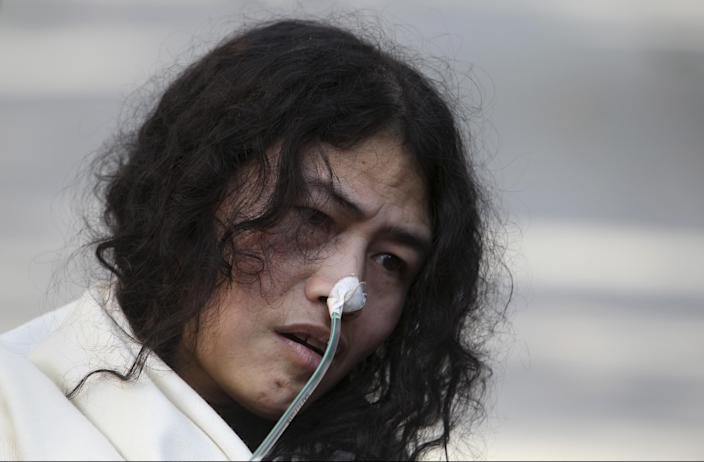 India's Irom Sharmila, who has been on a hunger strike for 12 years to protest an Indian law that suspends many human rights protections in areas of conflict, speaks during a press conference, in New Delhi, India, Monday, March 4, 2013. Sharmila who has been force fed through a tube by authorities was charged Monday with attempted suicide in a case likely to bring major attention to her quiet protest in the tiny northeastern state of Manipur against the Armed Forces Special Powers Act. (AP Photo/Tsering Topgyal)