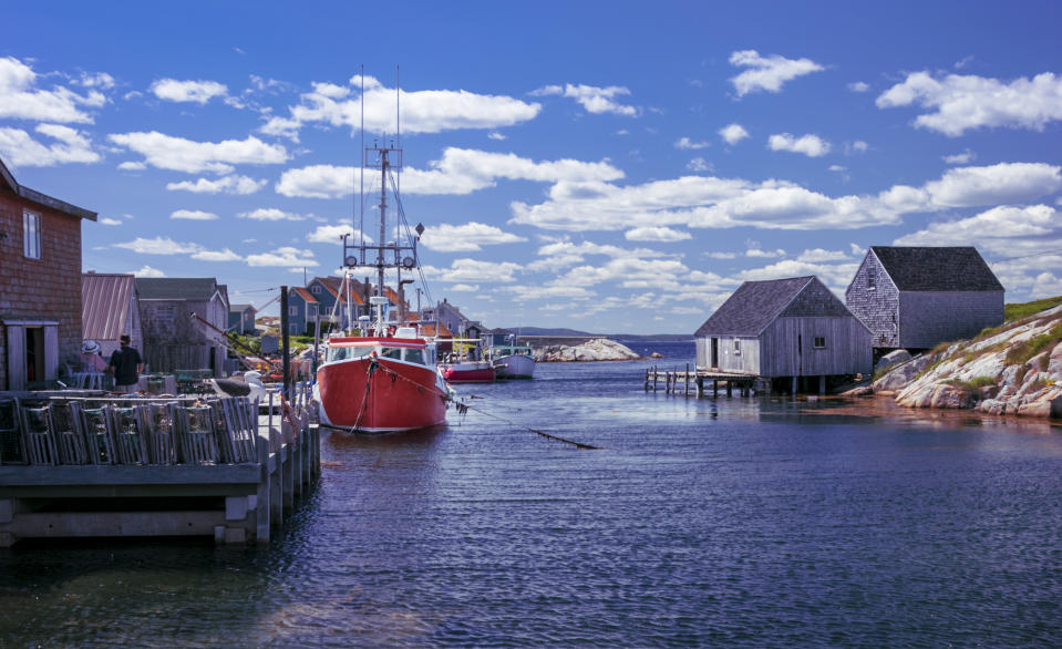 Boats docked at the wharf on a beautiful summer's day in Nova Scotia's iconic fishing community of Peggy's Cove.