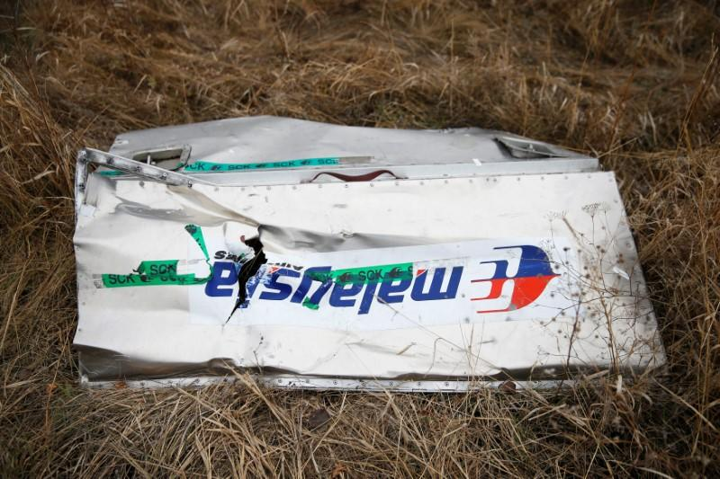 FILE PHOTO: A part of the wreckage of the downed Malaysia Airlines Flight MH17 is seen at its crash site near the village of Hrabove