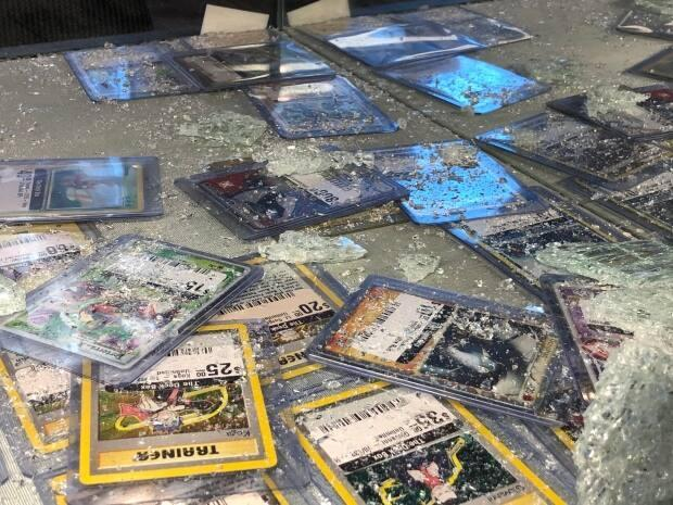 Some of the cards left in the smashed display case at the Deck Box.