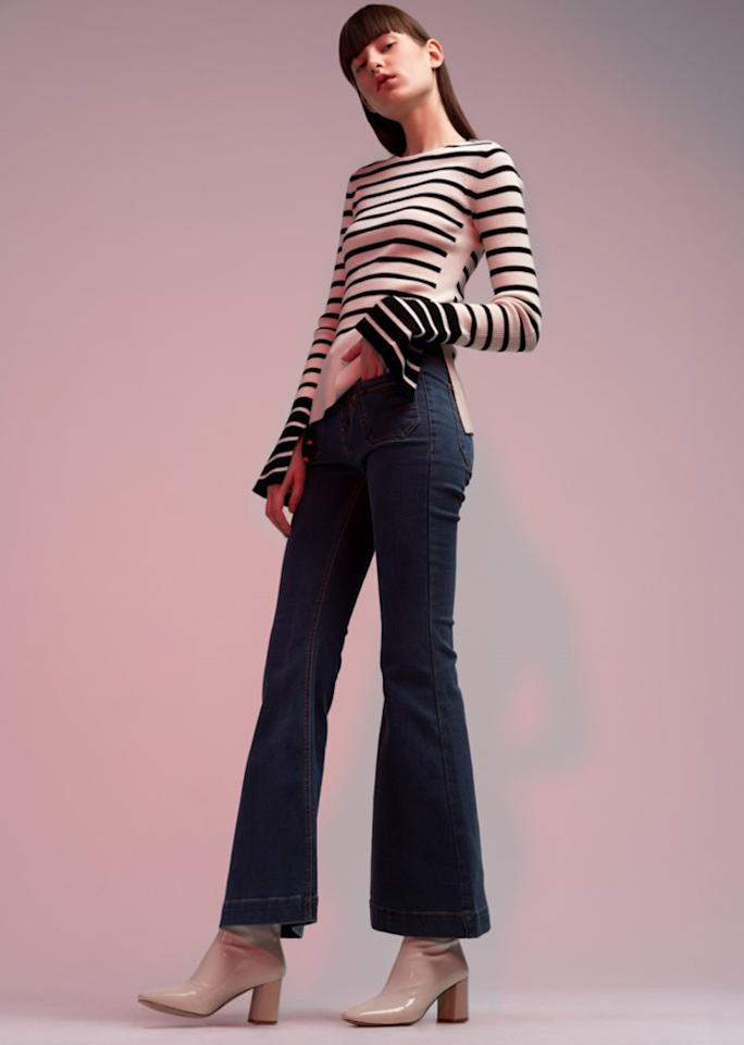 "Striped Bell Sleeved Sweater, $99; at <a rel=""nofollow"" href=""https://genuine-people.com/"" rel="""">Genuine People</a>  Flare Jeans, $168; at <a rel=""nofollow"" href=""https://genuine-people.com/"" rel="""">Genuine People</a>"
