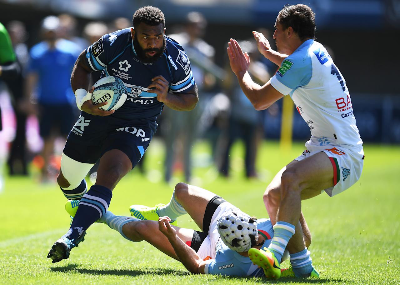 Montpellier's Fijian wing Timoci Nagusa (L) runs with the ball during the French Top 14 rugby union match Montpellier vs Bayonne on April 16 , 2017 at the Altrad stadium in Montpellier. (AFP Photo/PASCAL GUYOT)