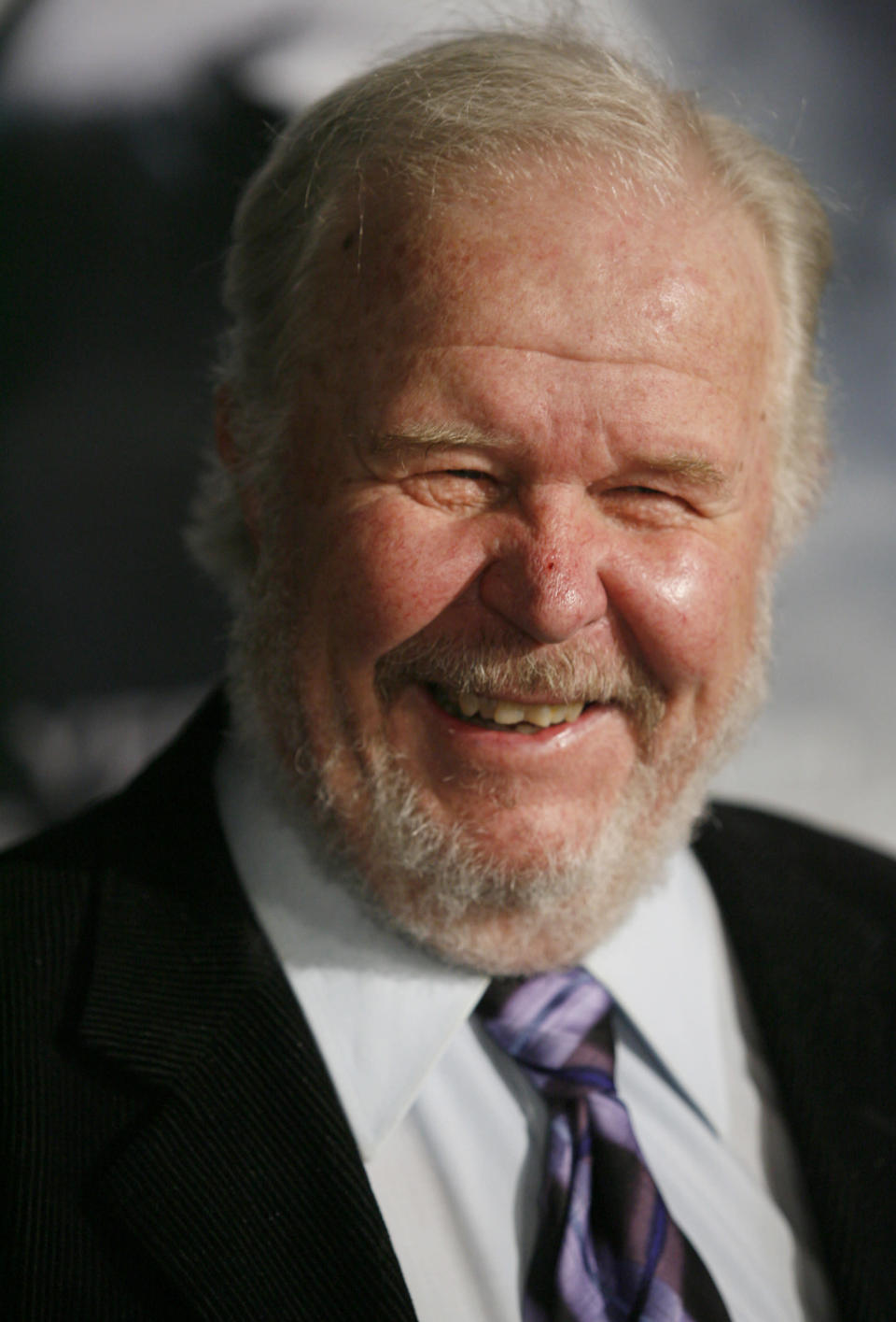 """FILE - In this Thursday, March 8, 2007, file photo, actor Ned Beatty arrives at the premiere of the movie """"Shooter,"""" in Los Angeles. Beatty, the indelible character actor whose first film role, as a genial vacationer raped by a backwoodsman in 1972′s """"Deliverance,"""" launched him on a long, prolific and accomplished career, died Sunday, June 13, 2021. He was 83. (AP Photo/Gus Ruelas, File)"""