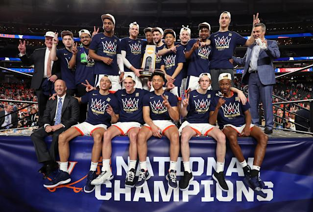 The Virginia Cavaliers celebrate with the trophy after their 85-77 win over the Texas Tech Red Raiders during the 2019 NCAA men's Final Four National Championship game at U.S. Bank Stadium on April 08, 2019 in Minneapolis, Minnesota. (Photo by Tom Pennington/Getty Images)