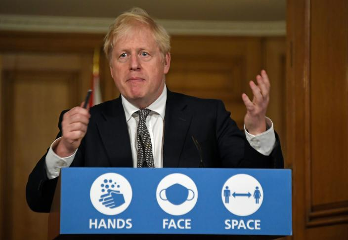 Britain's Prime Minister Boris Johnson speaks during a virtual press conference inside 10 Downing Street in central London on October 31, 2020 to announce new lockdown restrictions in an effort to curb rising infections of the novel coronavirus. - UK Prime Minister Boris Johnson on Saturday announced a new four-week coronavirus lockdown across England, a dramatic strategy shift following warnings hospitals would become overwhelmed under his current system of localised restrictions. (Photo by Alberto Pezzali / POOL / AFP) (Photo by ALBERTO PEZZALI/POOL/AFP via Getty Images)