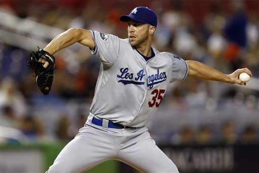 Los Angeles Dodgers starter Chris Capuano pitches to the Miami Marlins during the third inning of a baseball game in Miami, Sunday, Aug. 12, 2012. (AP Photo/J Pat Carter)
