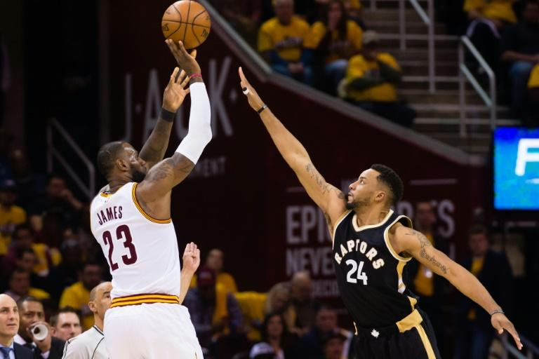 LeBron James of the Cleveland Cavaliers shoots over Norman Powell of the Toronto Raptors during Game Two of the NBA Eastern Conference semifinals