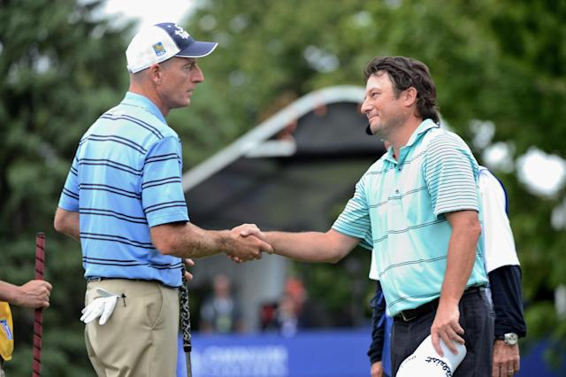 CORRECTS SPELLING OF PHOTOGRAPHER'S NAME - Tournament winner Tim Clark, right, of South Africa, shakes hands with Jim Furyk, of the United States, on the 18th green after winning the Canadian Open golf championship in Montreal, Sunday, July 27, 2014. (AP Photo/The Canadian Press, Ryan Remiorz)