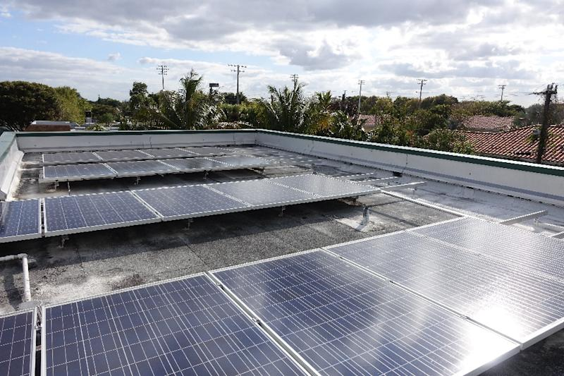 In Florida individuals with solar panels can't sell the extra power they produce and solar companies are barred from selling any power that they generate -- unless they sell it back to the utility company (AFP Photo/Kerry Sheridan)