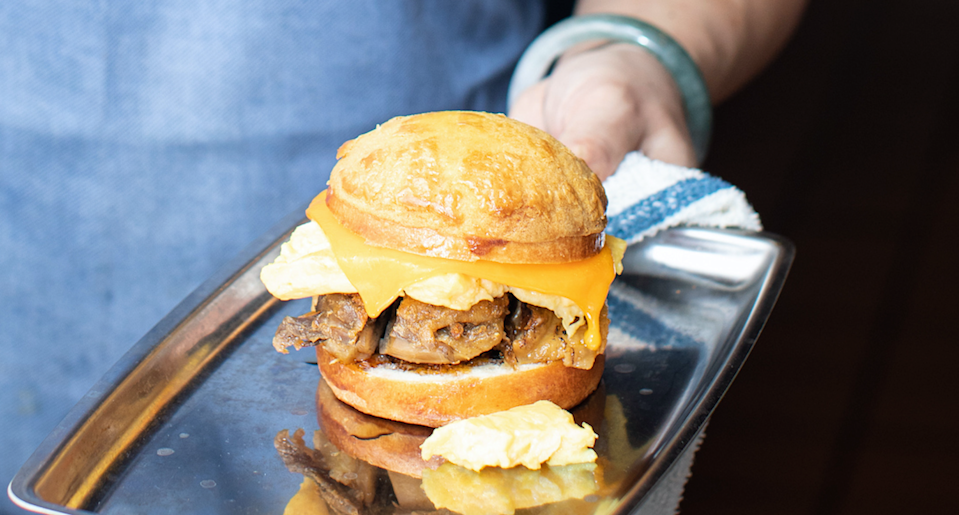 """<div class=""""cell medium-auto caption"""">Milu's has a pork-free take on the bacon, egg and cheese.</div> <div class=""""cell medium-shrink medium-text-right credit"""">Clay Williams</div>"""