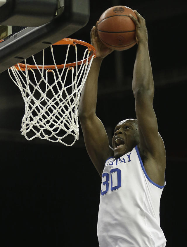 FILe - In this March 14, 2014 file photo, Kentucky forward Julius Randle (30) dunks the ball against LSU during the second half of an NCAA college basketball game in the quarterfinal round of the Southeastern Conference men's tournament, in Atlanta. Randle will leave after one season to enter the NBA draft, where he is expected to be among the top five selections. With five days left before the deadline for underclassmen to declare, the 6-foot-9 Dallas native announced, Tuesday, April 22, 2014, the decision many expected even before he arrived as part of Kentucky's best recruiting class ever. (AP Photo/Steve Helber, File)