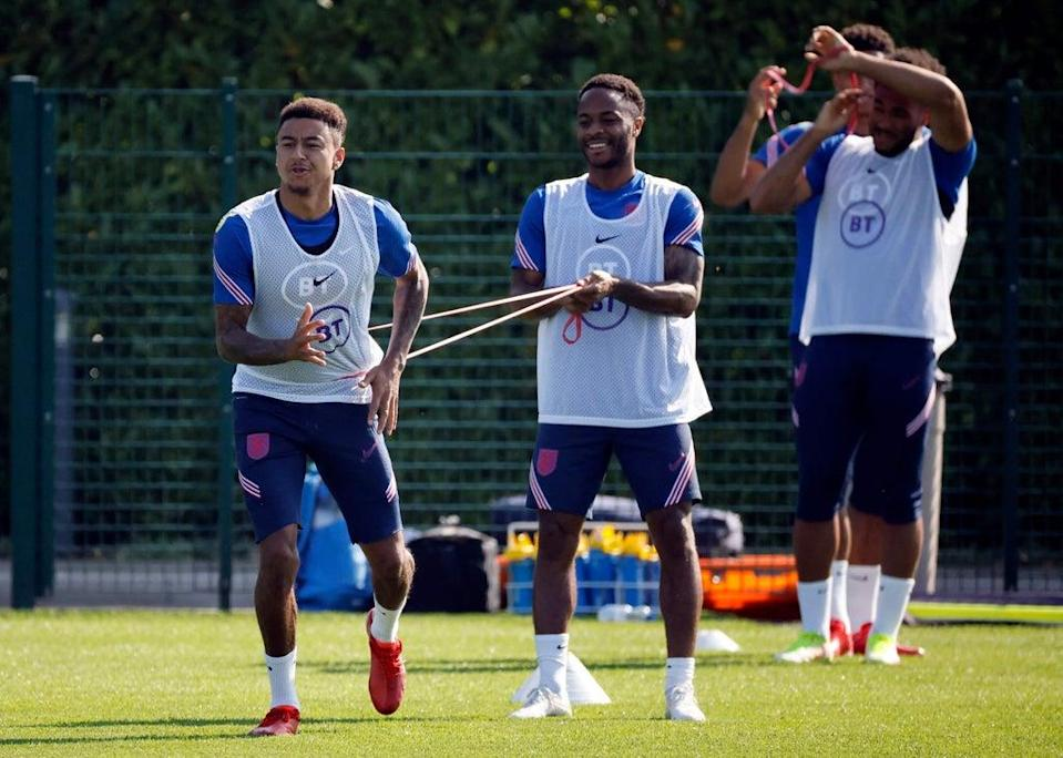 Jesse Lingard and Raheem Sterling during  an England training session (AFP via Getty Images)