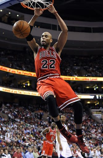 Chicago Bulls' Taj Gibson dunks against the Philadelphia 76ers during the first half of Game 4 in a first-round NBA basketball playoff series, Sunday, May 6, 2012, in Philadelphia. (AP Photo/Michael Perez)