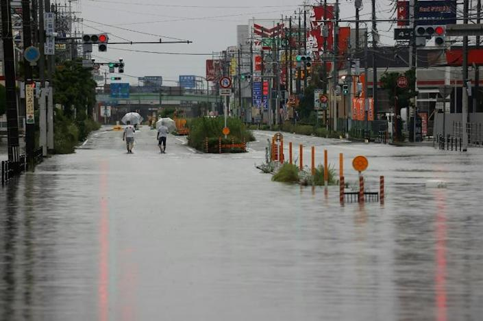 The rains have turned roads into rivers (AFP Photo/STR)