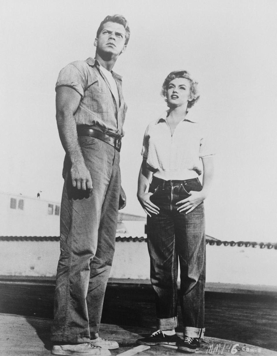 <p>In the early '50s, Levi's started selling women's jeans more widespread throughout the country, while Marilyn Monroe made jeans even more popular by wearing her pair (cuffed, dark indigo, and super boxy) in the first film where she received top billing, <em>Clash By Night</em>.</p>