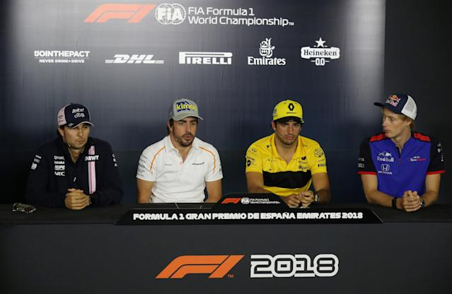 Formula One F1 - Spanish Grand Prix - Circuit de Barcelona-Catalunya, Barcelona, Spain - May 10, 2018 Force India's Sergio Perez, McLaren's Fernando Alonso, Renault's Carlos Sainz and Toro Rosso's Brendon Hartley during a press conference ahead of the Spanish Grand Prix REUTERS/Albert Gea