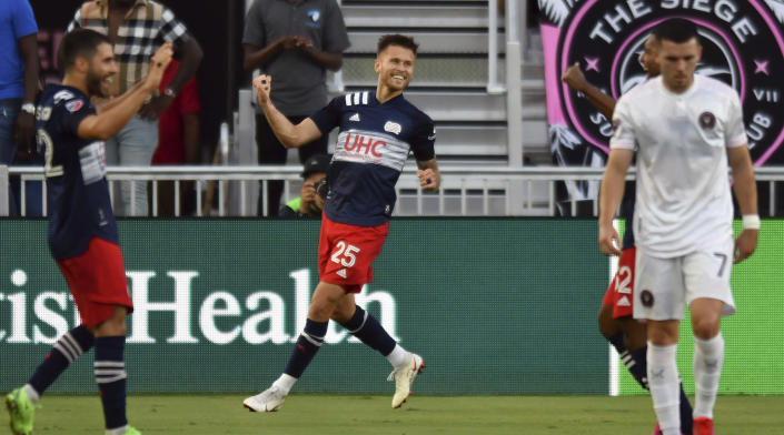 New England Revolution midfielder Arnor Ingvi Traustason (25) celebrates a goal against Inter Miami early in the first half of an MLS soccer match Wednesday, July 21, 2021, in Fort Lauderdale, Fla. (AP Photo/Jim Rassol)